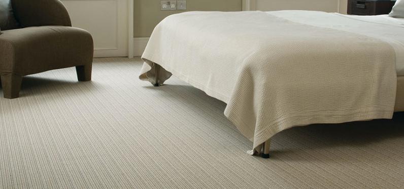 wool or man made carpets